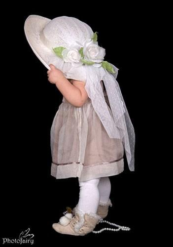 תמונת תינוקת בסגנון הולי הובי