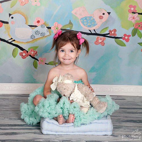 ילדה מתוקה עם קוקיות- צילום ילדים בסטודיו