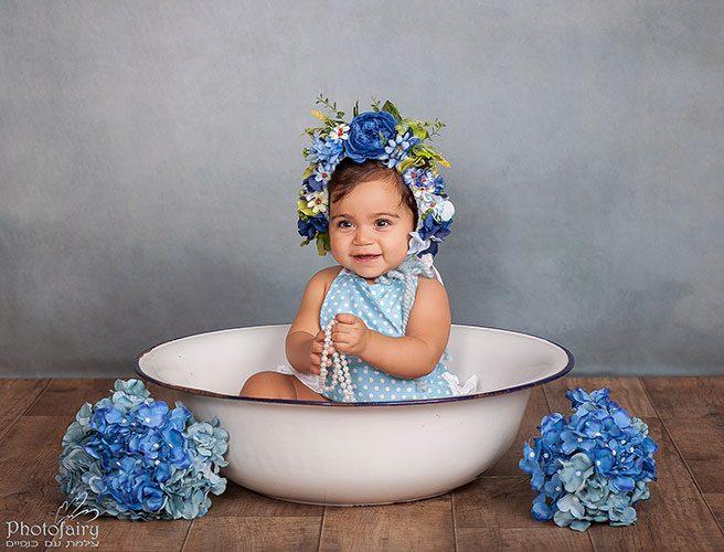 צילום תינוקת עם כובע פרחים משגע