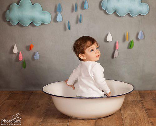 צילומי תינוקות. תינוק מתוק עם עננים