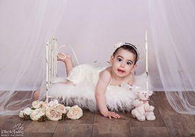 צילום תינוקות בגיל תשעה חודשים